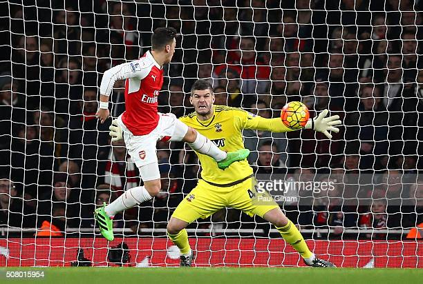Mesut Ozil of Arsenal shoots at goal during the Barclays Premier League match between Arsenal and Southampton at the Emirates Stadium on February 2...