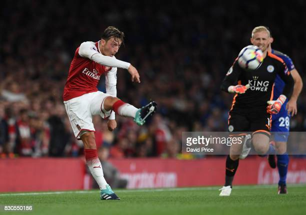 Mesut Ozil of Arsenal shoots at goal with Kasper Schmeichel of Leicester out of position during the Premier League match between Arsenal and...