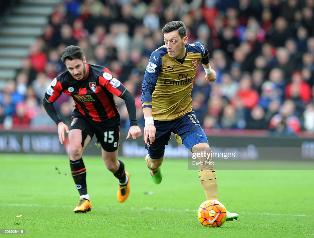 Mesut Ozil of Arsenal takes on <a gi-track='captionPersonalityLinkClicked' href=/galleries/search?phrase=Adam+Smith+-+Soccer+Right+Back&family=editorial&specificpeople=14054674 ng-click='$event.stopPropagation()'>Adam Smith</a> of Bournemouth during the Barclays Premier League match between AFC Bournemouth and Arsenal at The Vitality Stadium, Bournemouth 7th February 2016.