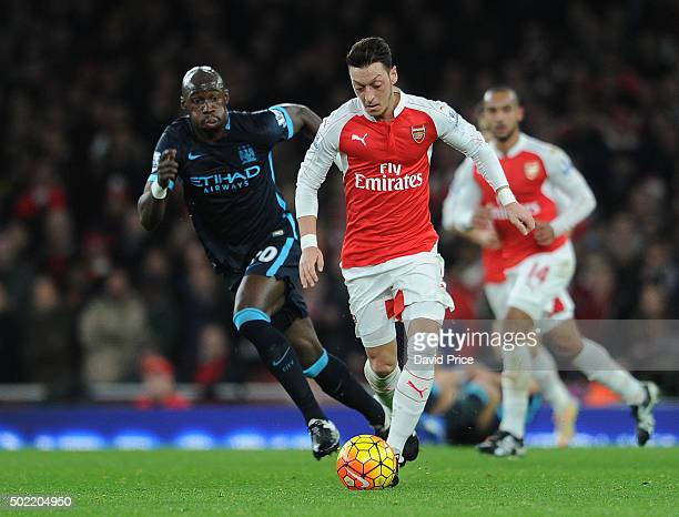 Mesut Ozil of Arsenal takes on Eliaquim Mangala of Man City during the Barclays Premier League match between Arsenal and Manchester City at Emirates...