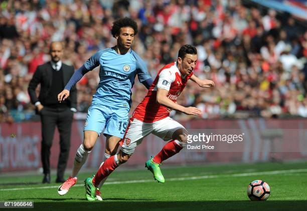 Mesut Ozil of Arsenal takes on Leroy Sane of Manchester City during the match between Arsenal and Manchester City at Wembley Stadium on April 23 2017...