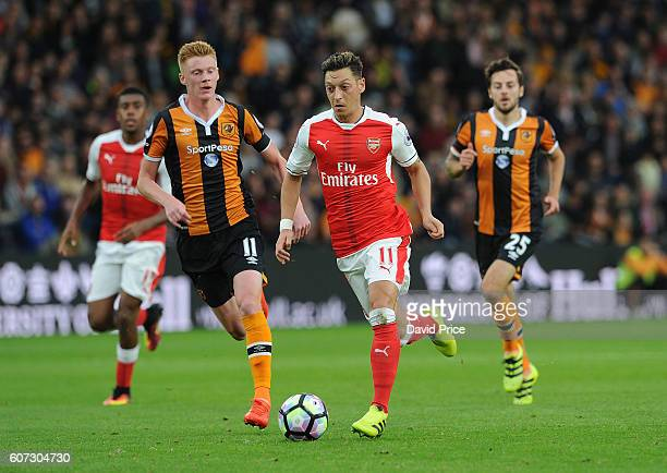 Mesut Ozil of Arsenal takes on Sam Clucas of Hull during the Premier League match between Hull City and Arsenal at KCOM Stadium on September 17 2016...