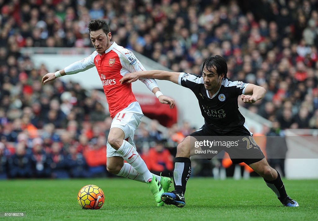 Mesut Ozil of Arsenal takes on Shinji Okazaki of Leicester during the Barclays Premier League match between Arsenal and Leicester City at Emirates Stadium on February 14th, 2016 in London, England