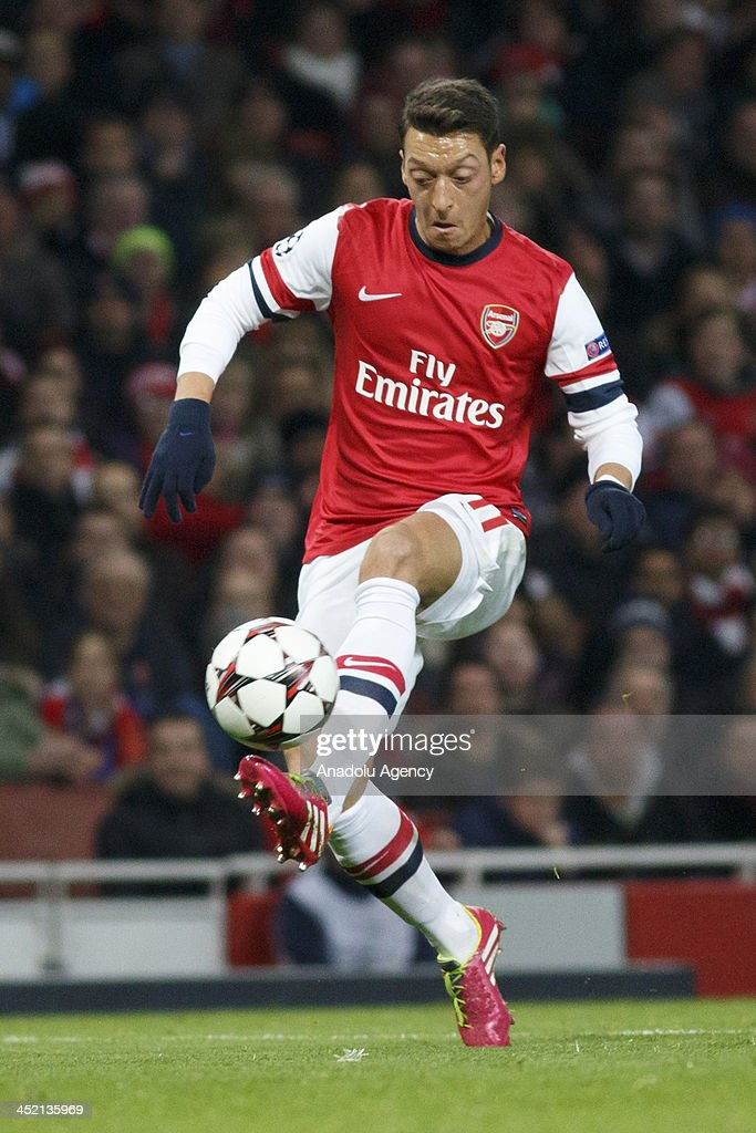 Mesut Ozil of Arsenal vies for the ball during the UEFA Champions League group F football match between Arsenal and Olympique de Marseille at the Emirates Stadium on November 26, 2013 in London, England.