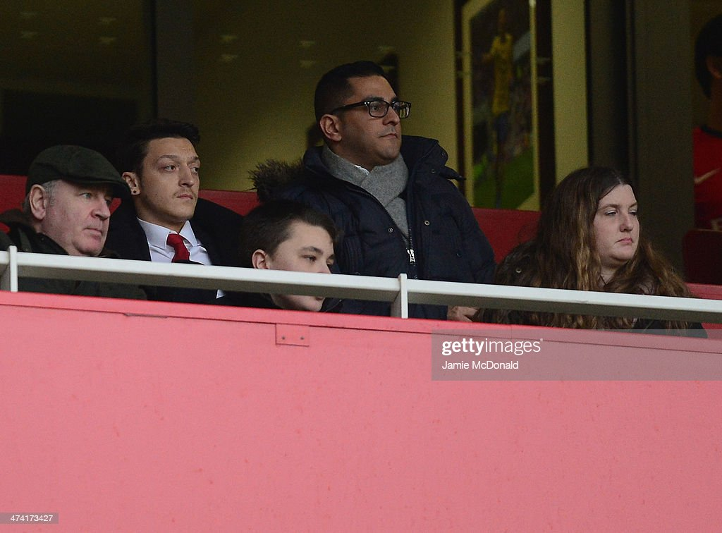 Mesut Ozil of Arsenal watches from the stands during the Barclays Premier League match between Arsenal and Sunderland at Emirates Stadium on February 22, 2014 in London, England.