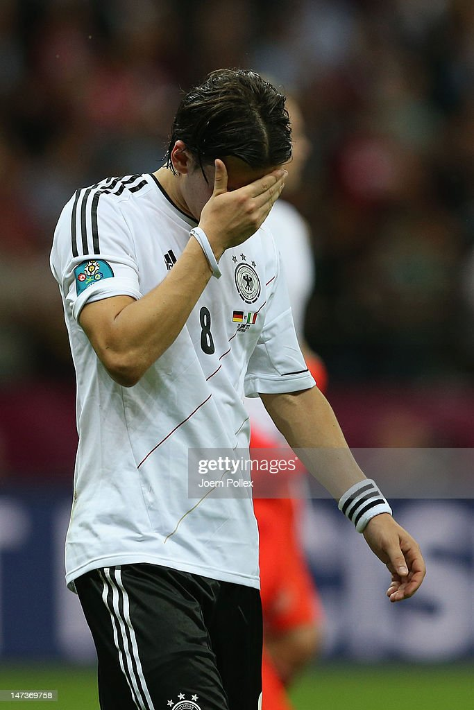 Mesut Ozil of Germany appears dejected after the UEFA EURO 2012 semi final match between Germany and Italy at the National Stadium on June 28, 2012 in Warsaw, Poland.