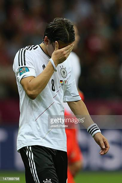 Mesut Ozil of Germany appears dejected after the UEFA EURO 2012 semi final match between Germany and Italy at the National Stadium on June 28 2012 in...