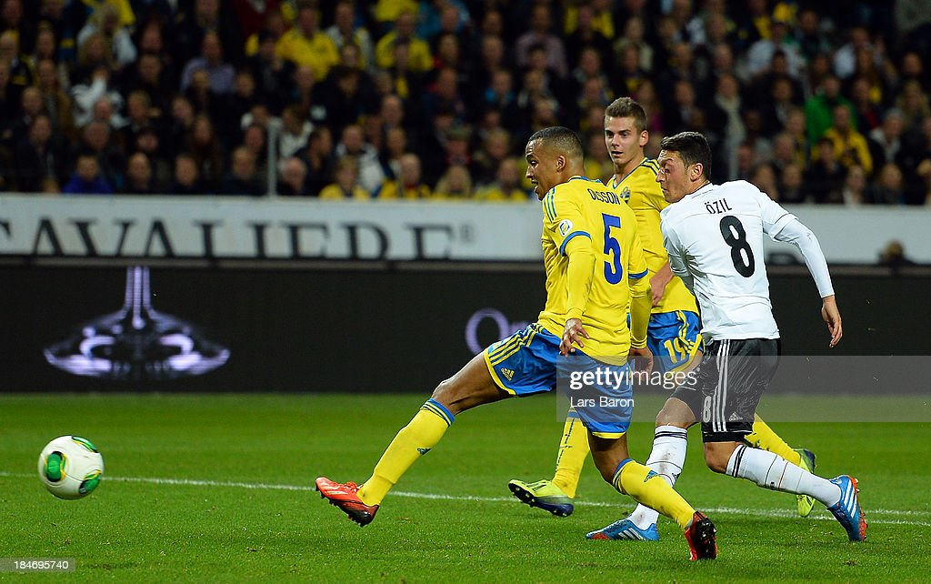 Mesut Ozil of Germany scores his teams first goal during the FIFA 2014 World Cup Qualifying Group C match between Sweden and Germany at Friends Arena Solna on October 15, 2013 in Stockholm, Sweden.