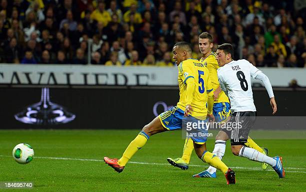 Mesut Ozil of Germany scores his teams first goal during the FIFA 2014 World Cup Qualifying Group C match between Sweden and Germany at Friends Arena...