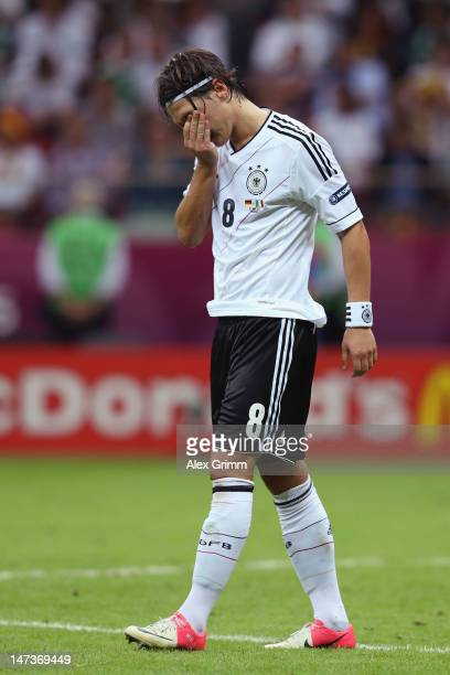 Mesut Ozil of Germany shows his dejection during the UEFA EURO 2012 semi final match between Germany and Italy at the National Stadium on June 28...