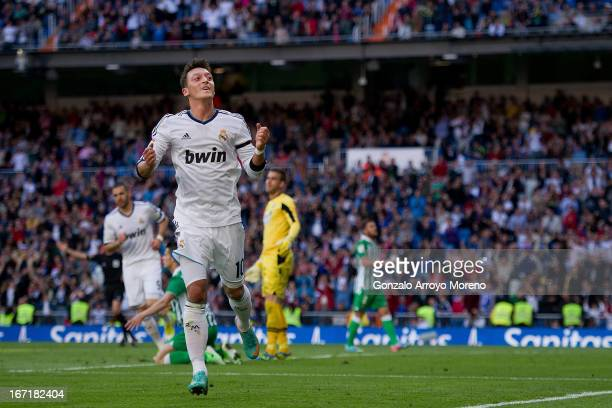 Mesut Ozil of Real Madrid CF celebrates scoring their opening goal during the La Liga match between Real Madrid CF and Real Betis Balompie at...