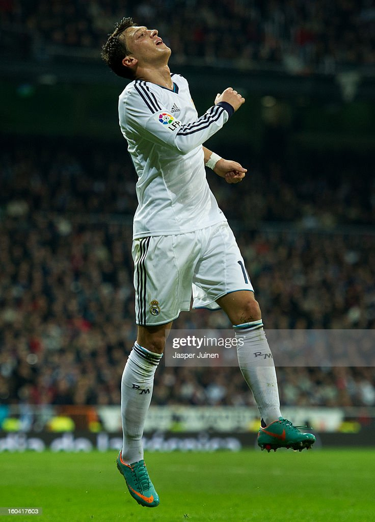 Mesut Ozil of Real Madrid reacts during the Copa del Rey semi final first leg match between Real Madrid CF and FC Barcelona at the Estadio Santiago Bernabeu on January 30, 2013 in Madrid, Spain.