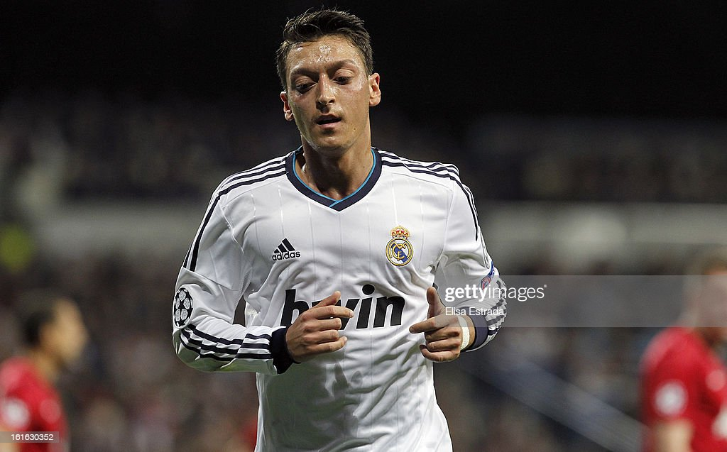 Mesut Ozil of Real Madrid runs during the UEFA Champions League Round of 16 first leg match between Real Madrid and Manchester United at Estadio Santiago Bernabeu on February 13, 2013 in Madrid, Spain.