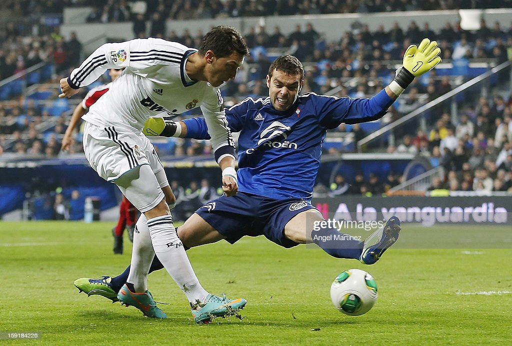 Mesut Ozil of Real Madrid shoots towards goal past Sergio Alvarez of Celta de Vigo during the Copa del Rey round of 16 second leg match between Real Madrid and Celta de Vigo at Estadio Santiago Bernabeu on January 9, 2013 in Madrid, Spain.