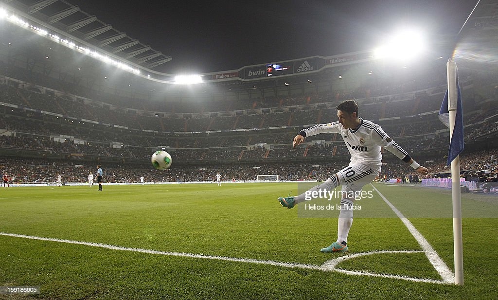 Mesut Ozil of Real Madrid takes a corner during the round of 16 Copa del Rey second leg match between Real Madrid and Celta de Vigo at Estadio Santiago Bernabeu on January 9, 2013 in Madrid, Spain.