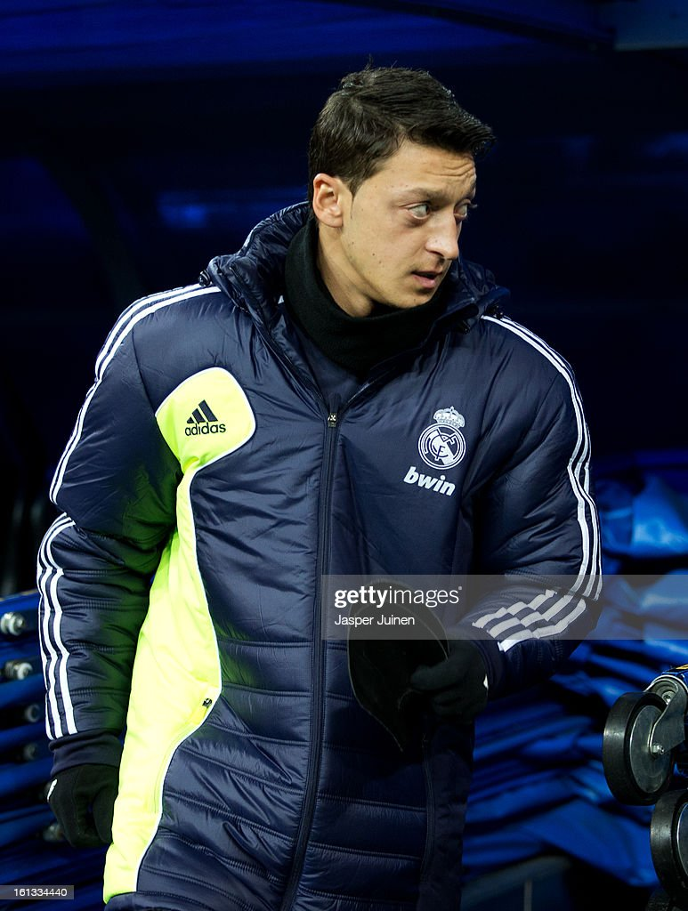 Mesut Ozil of Real Madrid takes his place on the bench prior to the start of the la Liga match between Real Madrid CF and Sevilla FC at Estadio Santiago Bernabeu on February 9, 2013 in Madrid, Spain.