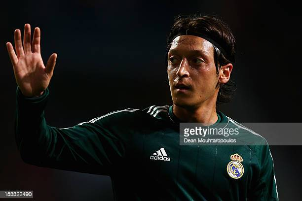 Mesut Ozil of Real Madrid walks to take a corner during the UEFA Champions League Group D match between Ajax Amsterdam and Real Madrid at Amsterdam...