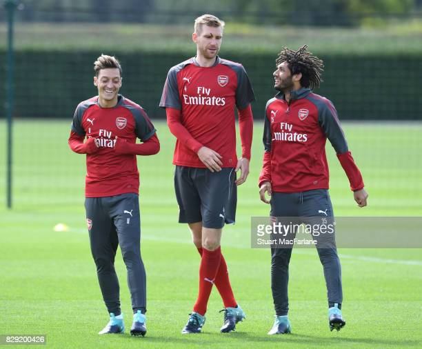 Mesut Ozil Per Mertesacker and Mohamed Elneny of Arsenal during a training session at London Colney on August 10 2017 in St Albans England