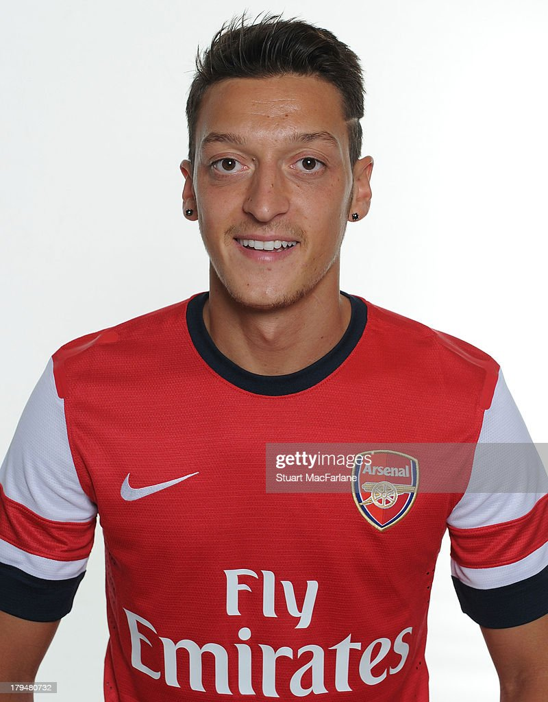 Mesut Ozil poses after signing for Arsenal FC on September 4, 2013 in Munich, Germany.