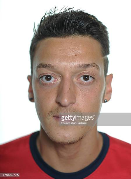 Mesut Ozil poses after signing for Arsenal FC on September 4 2013 in Munich Germany