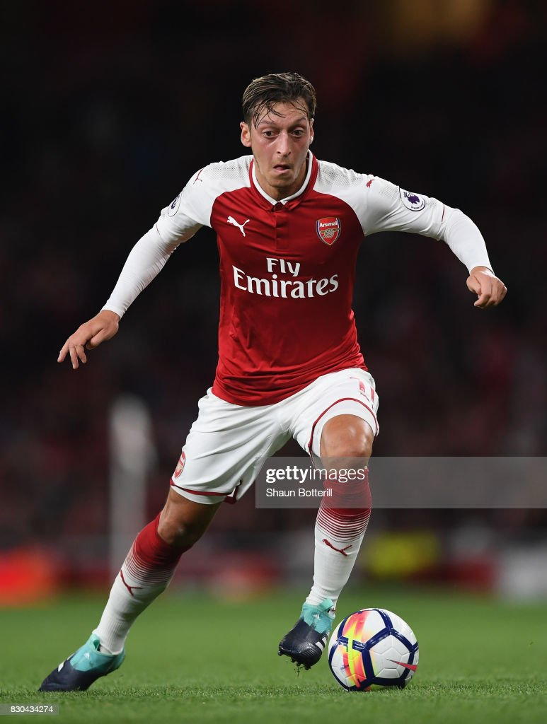 Mesut Ozil running with the ball during the Premier League match between Arsenal and Leicester City at Emirates Stadium on August 11, 2017 in London, England.