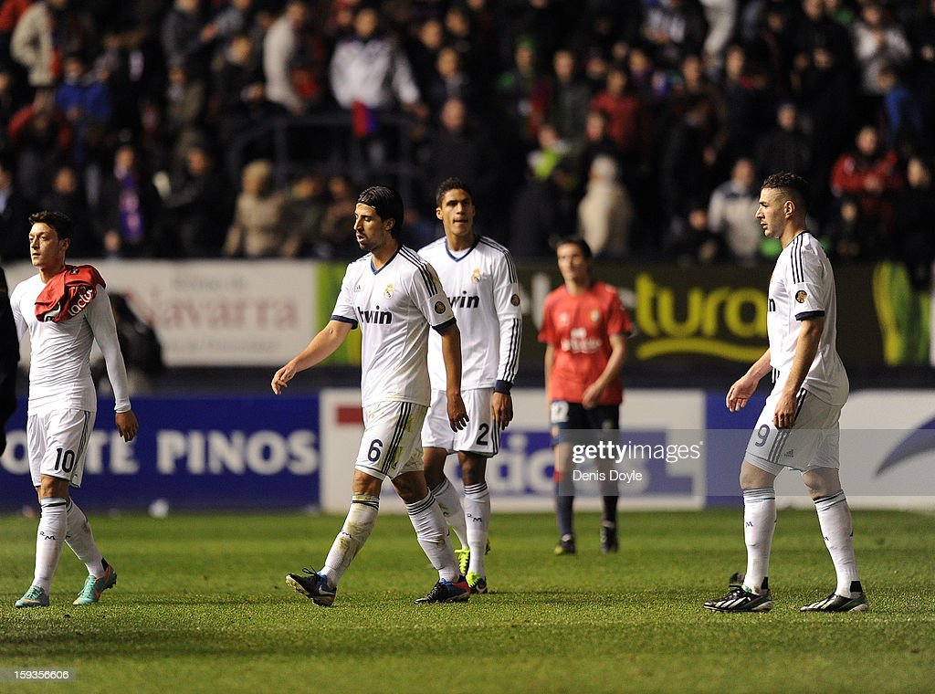 Mesut Ozil (L), Sami Khedira (2.L), Raphael Verane (C) and Karim Benzema of Real Madrid leave the field of play after their side drew 0-0 against Osasuna during the La Liga match between Osasuna and Real Madrid at estadio Reino de Navarra on January 12, 2013 in Pamplona, Spain.