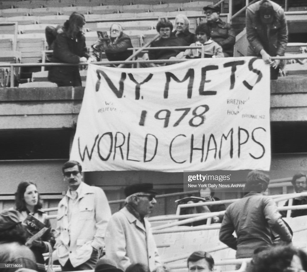 Met fans with a sense of humor hold banner that reads 'NY Mets 1978 World Champs' during opening day on April 7 1978 at Shea Stadium in the Flushing...