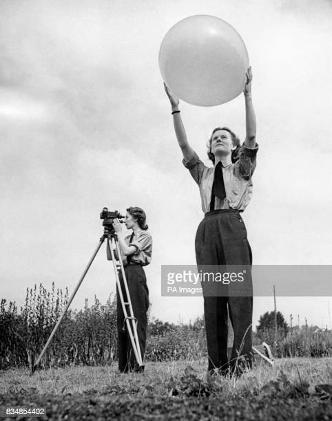 RAF 'Met' girls at Uxbridge Weather Station LACW B Dean prepares to release the balloon which is used to record movements in the atmosphere at...