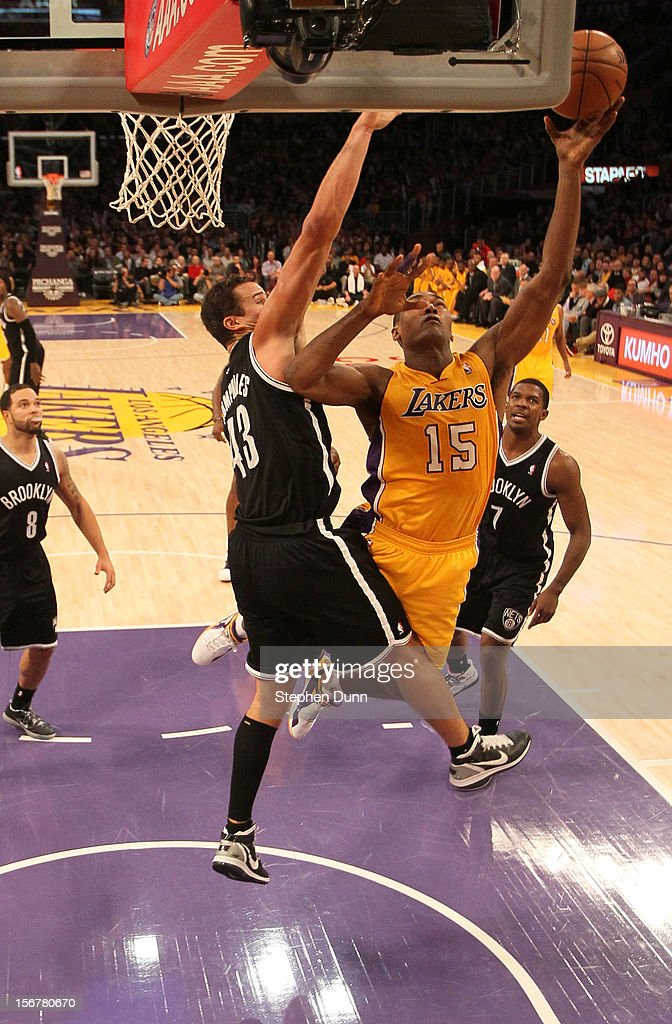 Meta World Peace #15 of the Los Angeles Lakers shoots over <a gi-track='captionPersonalityLinkClicked' href=/galleries/search?phrase=Kris+Humphries&family=editorial&specificpeople=209199 ng-click='$event.stopPropagation()'>Kris Humphries</a> #43 of the Brooklyn Nets at Staples Center on November 20, 2012 in Los Angeles, California. The Lakers won 95-90.