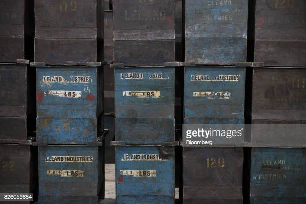 Metal bins sit stacked in a storage area at the Leland Industries Inc fasteners factory in Toronto Ontario Canada on Wednesday Jan 11 2017 Statistics...
