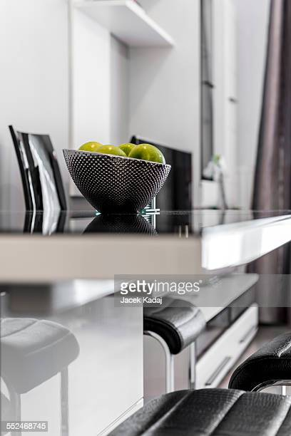 Metal bowl with fruits on table