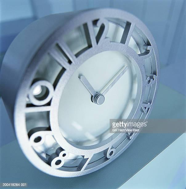 Metal clock on plinth, close-up