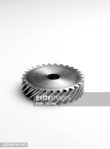 Metal cog, against white background, close-up