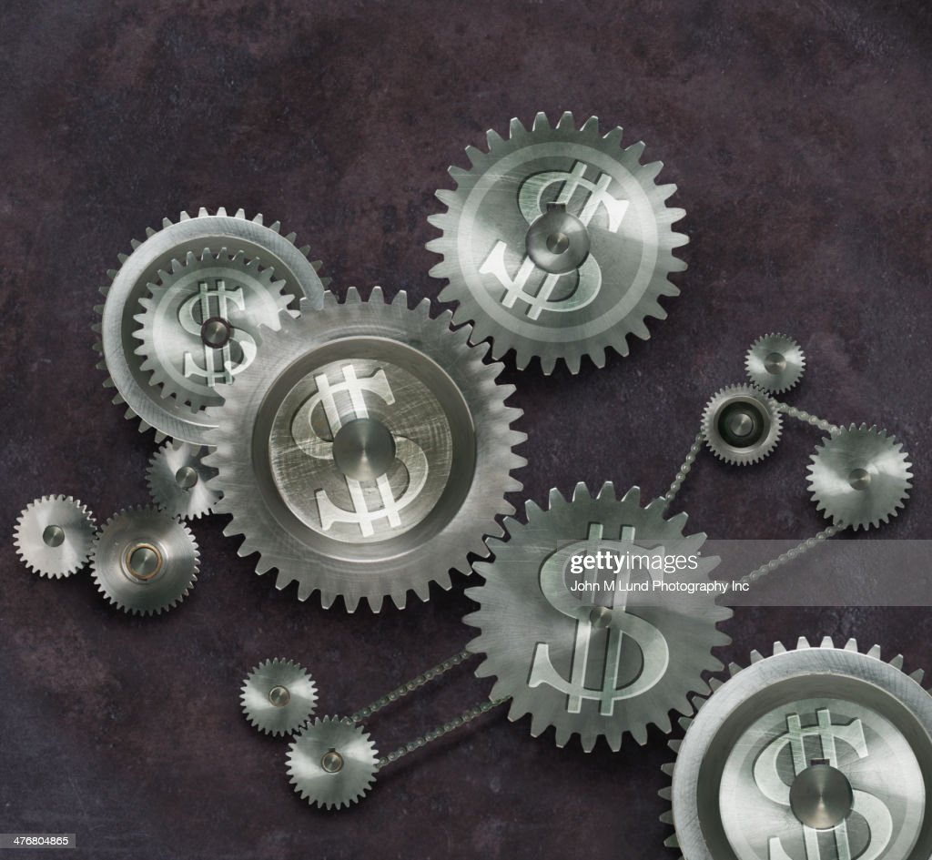 Metal cogs with dollar signs : Stock Photo