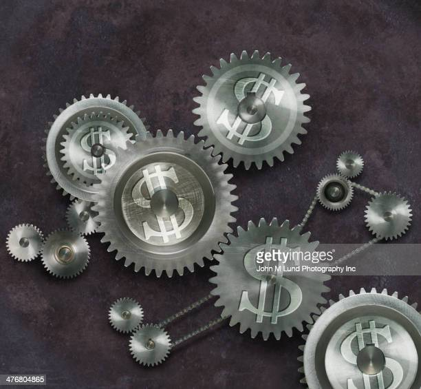 Metal cogs with dollar signs