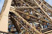 Closeup of metal girders and framing constructions of famous Eiffel Tower in Paris