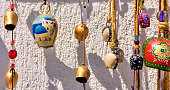 Metal cow bells painted in bright colors are atypical Greek souvenirs bought by international tourists.