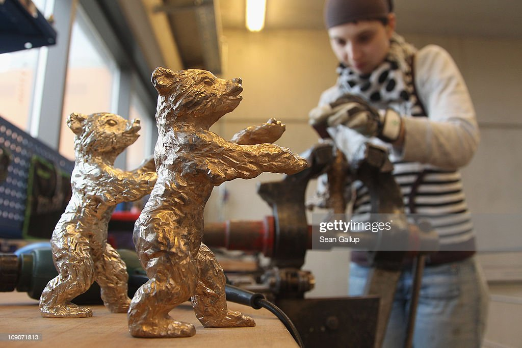 Metal crafts worker Christiane Reum puts finishing touches on a bronzecast Berlinale Bear before it will be sent off for gold plating at the Hermann...