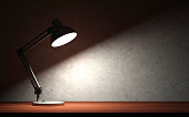 Metal Desk Lamp at Night on the Wooden Table