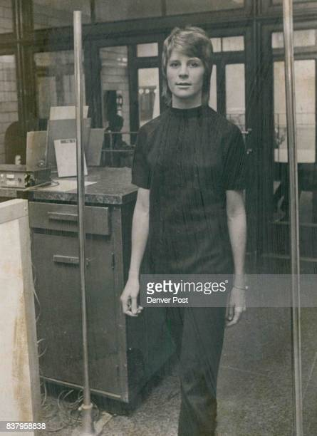 Metal Detector Guards Against Bombs Susie Jensen a police department employe passes through a metal detector that was installed at front door of the...