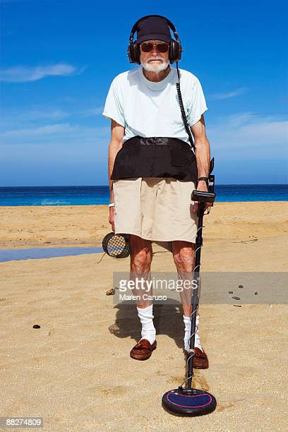 Metal detector man on the beach.