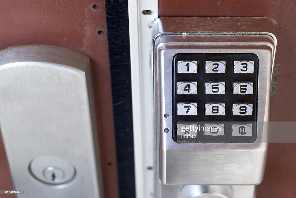 metal exterior door with electronic touch keypad combination lock stock photo getty images. Black Bedroom Furniture Sets. Home Design Ideas