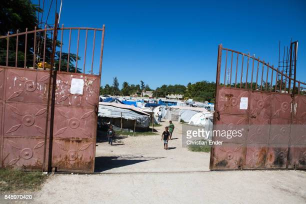 PortauPrince Haiti December 09 2012 A metal gate that is the entrance of the refugee camp Parc Colofe in PortauPrince The camp exist since the...