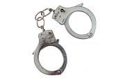 Arrest or bontage concept. Metal locked handcuffs isolated on white background, top view