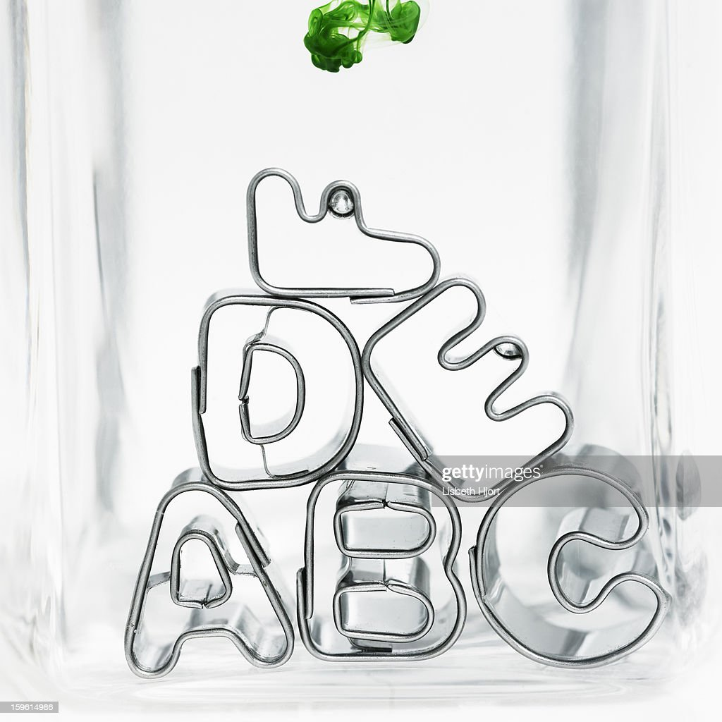 Metal letter shapes stacked together : Stock Photo