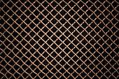 copper metal mesh or aluminum grid with regular pattern on black background