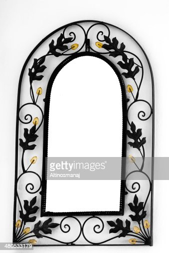 Metal mirror frame border on the wall : Stock Photo