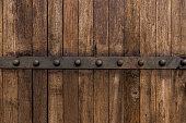 Metal on old wooden background for design