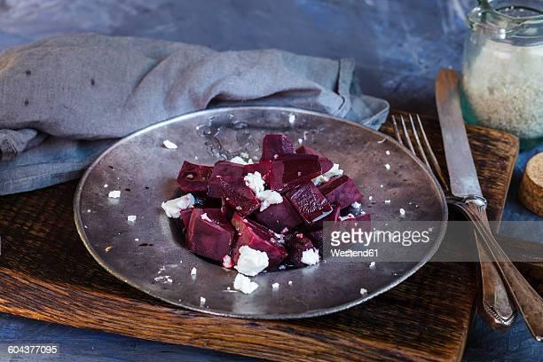 Metal plate of beetroot salad with feta and sea salt