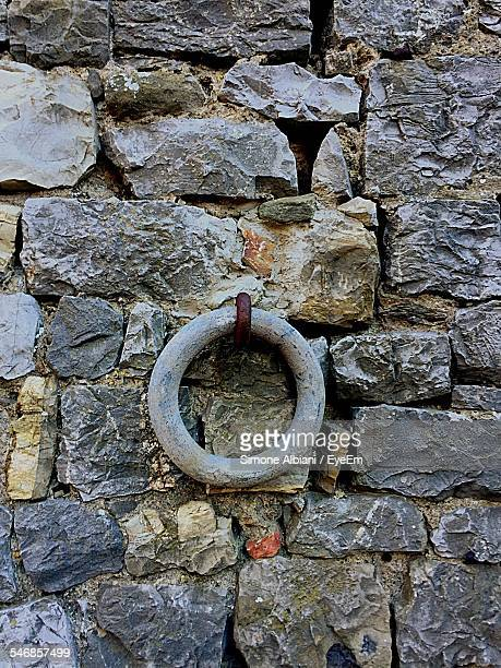 Metal Ring Hanging On Stone Wall